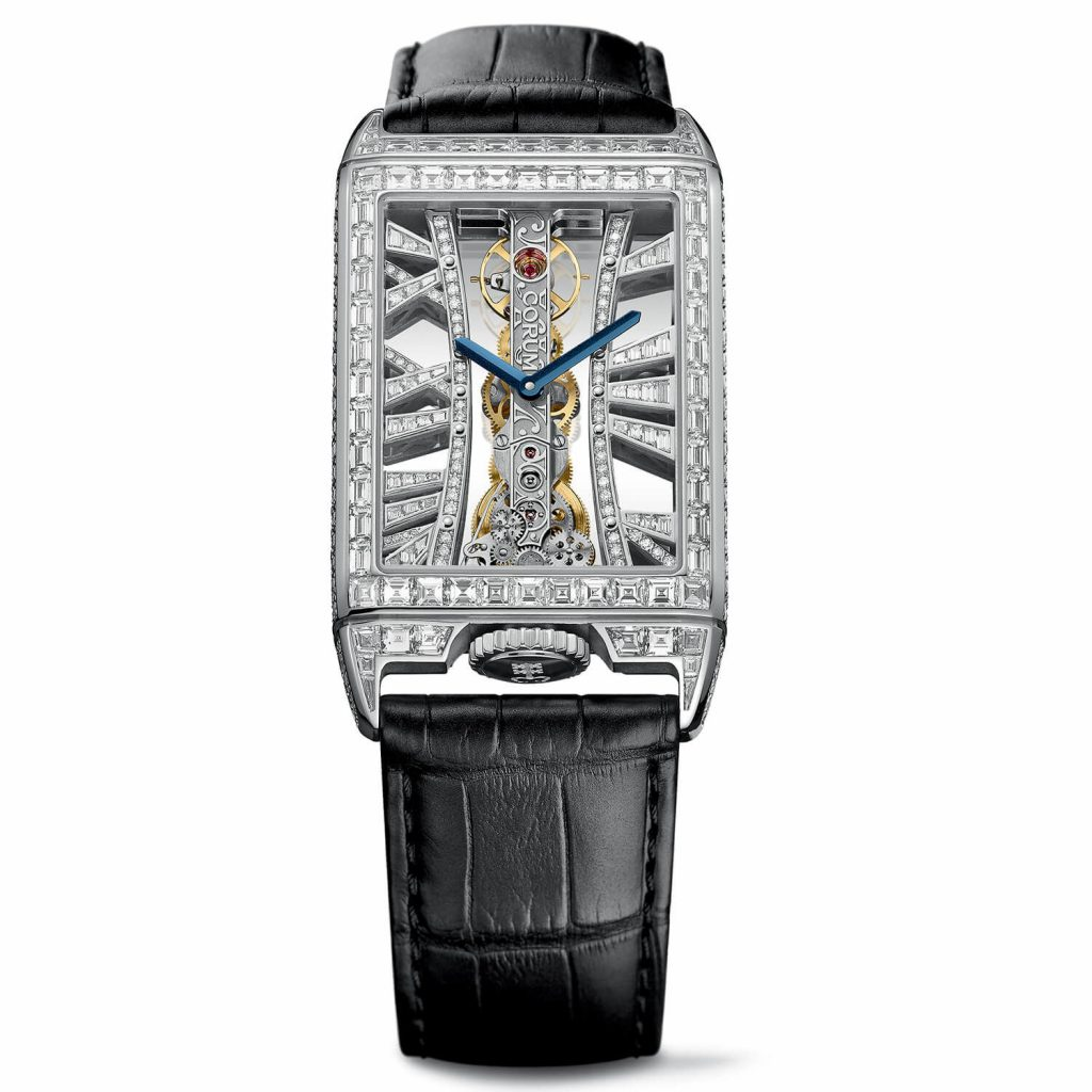 The blue baton-shaped hands are striking contrast to the diamonds paved dial.