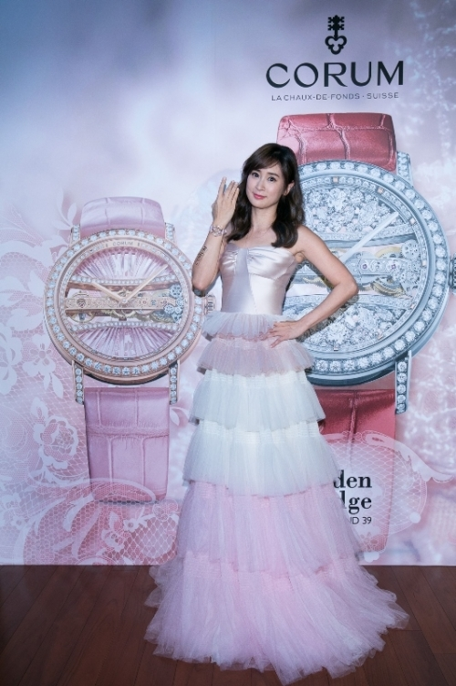 The pink Corum with diamonds paved rose gold case enhances the charm of the ladies perfectly.